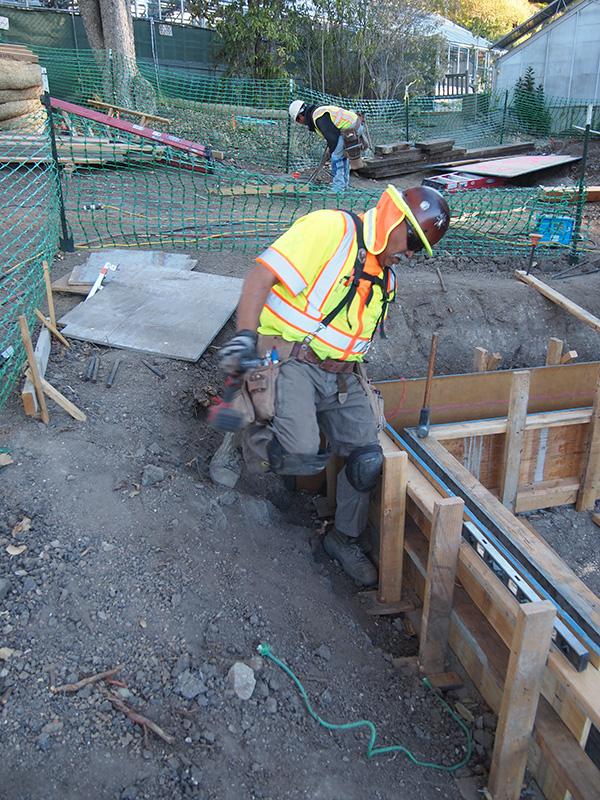 The foundation was complete on one side with sills in order to directly receive one side of the perimeter of the building. Concrete stem walls were constructed on the remaining sides after the building was in place.