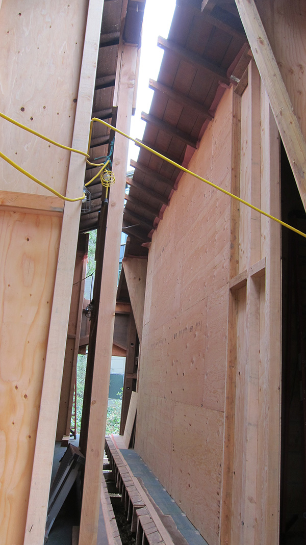 The roof sections, seen here supported by shoring, were eased together and pulled tight by come-alongs.